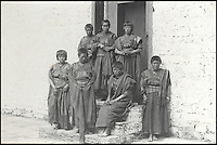 BNPS.co.uk (01202 558833)<br /> Pic: Bonhams/BNPS<br /> <br /> Sewing maids in old costumes.<br /> <br /> Fascinating 112 year-old photographs of Bhutan taken decades before the remote country in the Himalayas became open to outsiders have been unearthed.<br /> <br /> The images provide an unprecedented insight into the isolated kingdom nestled between India and China in the heart of the Himalayas at the beginning of the 20th century. <br /> <br /> The country was almost completely cut off for centuries as it sought to protect its ancient traditions and has only become more accessible to visitors since the 1970s. Such has been their desire to protect their heritage they didn't have TV until 1999.<br /> <br /> The photographs are believed to have belonged to the family of someone who took part in the expedition to Bhutan in 1905 and have since been passed to a private collector.<br /> <br /> The present owner has now decided to submit them for auction and they are tipped to sell for &pound;15,000.