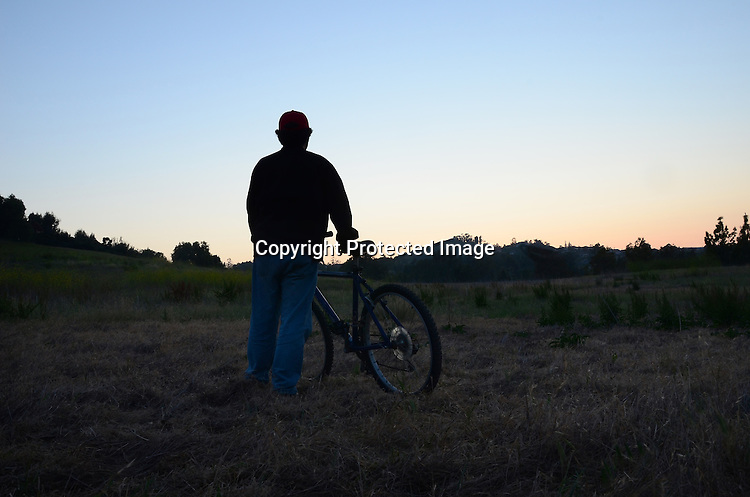 Stock photo of biker in the evening