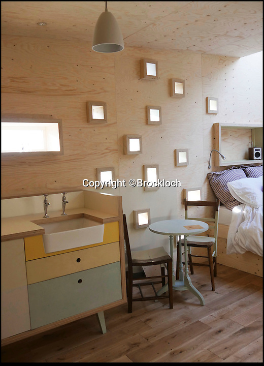 BNPS.co.UK (01202 558833)<br /> Pic: Brockloch/BNPS<br /> <br /> New 'Eco' treehouse is being booked up fast by romantic couples looking to get back to nature and discover their inner Tarzan and Jane.<br /> <br /> Futuristic Eco-hut offering a romantic retreat amongst the treetops is proving a run away success for Galloway farmer's George and Julie Nicolson.<br /> <br /> The Treehouse was designed as a cosy romantic hideaway for 2 people nestling in its very own Bluebell wood and surrounded by native broadleaved trees and the odd red squirrel.<br /> <br /> More than fifty tiny windows replicate dappled sunlight to enhance the treetop enviroment, and despte being very off grid it still provides a gas hob, small fridge, composting toilet and walls are insulated with wool to keep it nice and warm. The built in double bed also has a skylight to gaze at the  stars as you drift off to sleep.<br /> <br /> Visitors can truly relax and switch off without tv or wifi - just the rolling countryside and abundant wildlife.