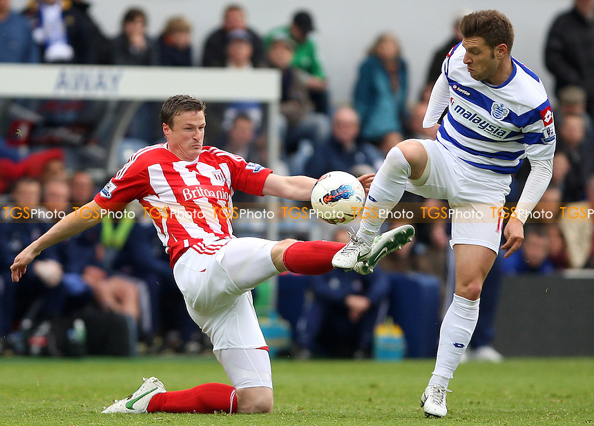 Robert Huth of Stoke challenges Akos Buzsaky of QPR - Queens Park Rangers vs Stoke City, Barclays Premier League at Loftus Road, London - 06/05/12 - MANDATORY CREDIT: Rob Newell/TGSPHOTO - Self billing applies where appropriate - 0845 094 6026 - contact@tgsphoto.co.uk - NO UNPAID USE..