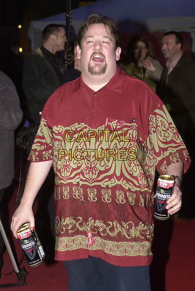 JOHNNY VEGAS.Arrivals at the Brit Awards at Earls Court  .guiness, beer cans, drinking, half length, half-length.*RAW SCAN - photo will be adjusted for publication*.www.capitalpictures.com.sales@capitalpictures.com.© Capital Pictures