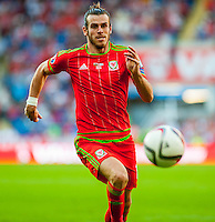 Gareth Bale  of Wales  runs with the ball during their UEFA EURO 2016 Group B qualifying round match held at Cardiff City Stadium, Cardiff, Wales, 06 September 2015. EPA/DIMITRIS LEGAKIS