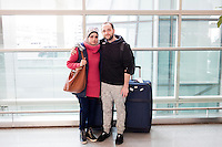 Karam (left, last name withheld), a Syrian with American citizenship living in Portland, Oregon, poses with his fiance (name withheld) after she arrived on a flight from Doha, Qatar, in Logan Airport's Terminal E in Boston, Massachusetts, USA. She had been trying to travel to the US for 3 days but had been denied plane tickets because of President Donald Trump's executive order banning travel to the US by citizens of seven Muslim-majority countries. When Karam found out about flights opening up to Boston that would allow people from Syria to travel, he traveled to Boston from Portland and waited for her arrival.