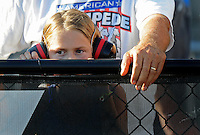 Sept. 19, 2010; Concord, NC, USA; A young NHRA fan wearing hearing protection during the O'Reilly Auto Parts NHRA Nationals at zMax Dragway. Mandatory Credit: Mark J. Rebilas-