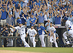 Royals team group,<br /> SEPTEMBER 30, 2014 - MLB :<br /> (L-R) Erik Kratz #19, Norichika Aoki #23, Jason Vargas and Eric Hosmer #35 of the Kansas City Royals celebrate as their teammate Salvador Perez (R) heads to first base after hitting the game winning RBI single in the bottom of the 12th inning during the American League Wild Card playoff baseball game against the Oakland Athletics at Kauffman Stadium in Kansas City, Missouri, United States. (Photo by AFLO)