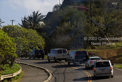United States President Barack Obama's Motorcade is seen in Kailua, Hawaii, Monday, December 26, 2011. President Obama, First Lady Michelle Obama, friends and family hiked the Keolu Hills Pillboxes trail..Credit: Kent Nishimura / Pool via CNP