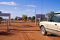 4WD car driving through gate in dingo fence at Hungerford, Queensland