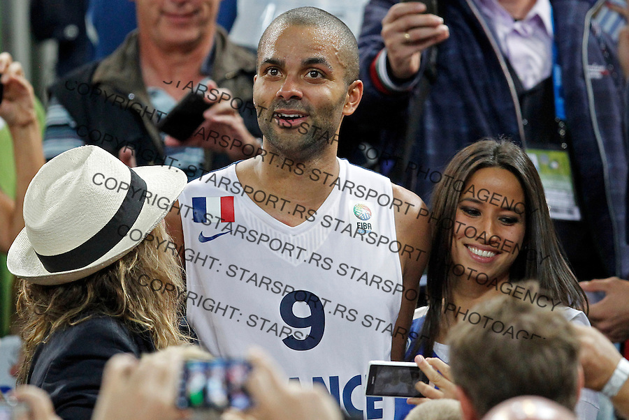 """France`s Tony Parker celebrate with French national basketball team suppoters and his girlfriend Axelle Francine (R) after European basketball championship """"Eurobasket 2013""""  final game between France and Lithuania in Stozice Arena in Ljubljana, Slovenia, on September 22. 2013. (credit: Pedja Milosavljevic  / thepedja@gmail.com / +381641260959)"""