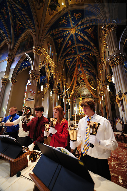 Handbell choir and celebration choir rehearse in the Basilica.