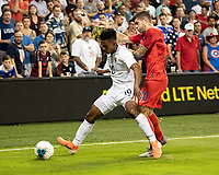 KANSAS CITY, KS - JUNE 26: Christian Pulisic #10 defends against Edgar Barcenas #10 during a game between Panama and USMNT at Children's Mercy Park on June 26, 2019 in Kansas City, Kansas.