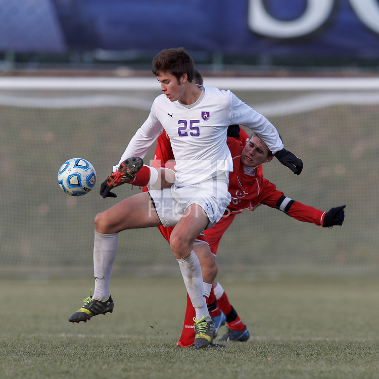 Amherst forward Greg Singer (25) attempts to control the ball as St. Lawrence midfielder Mark Provost (8) defends. NCAA Division III Sectionals. In double-overtime, Amherst College (white) defeated St. Lawrence University (red), 2-1, on Hitchcock Field at Amherst College on November 23, 2013.