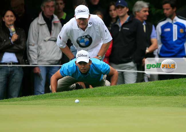 Pablo Larrazabal (ESP) and caddy John line up his putt on the 16th green during of Day 3 of the BMW International Open at Golf Club Munchen Eichenried, Germany, 25th June 2011 (Photo Eoin Clarke/www.golffile.ie)
