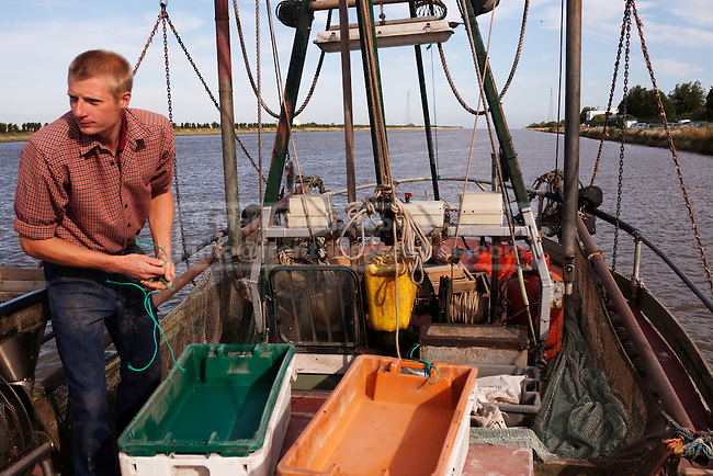 As the shrimper makes it's way to the mouth of the River Ouse, the son (and skipper) Jamie starts to get the deck equipment ready.