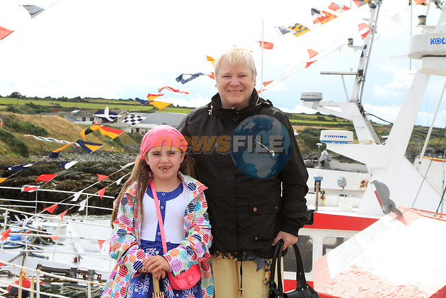 Caitlin Brennan and Olive McManus on the pier during the &quot;Blessing of the Boats&quot; on Sunday 10th August 2014.<br /> Picture:  Thos Caffrey / www.newsfile.ie