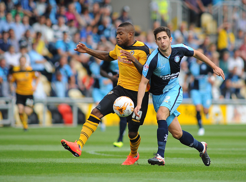 Newport County's Aaron O'Connor vies for possession with Wycombe Wanderers' Max Kretzschmar<br /> <br /> Photographer Kevin Barnes/CameraSport<br /> <br /> Football - The Football League Sky Bet League Two - Newport County AFC v Wycombe Wanderers - Saturday 9th August 2014 - Rodney Parade - Newport<br /> <br /> &copy; CameraSport - 43 Linden Ave. Countesthorpe. Leicester. England. LE8 5PG - Tel: +44 (0) 116 277 4147 - admin@camerasport.com - www.camerasport.com