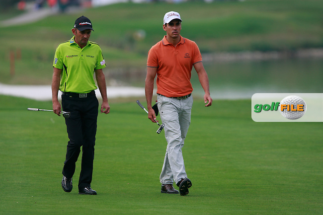 Markus Brier (AUT) and Rafael Cabrera-Bello (ESP) walk up to the 1st green during Friday's Round 2 of the Austrian Open presented by Lyoness at the Diamond Country Club, Atzenbrugg, Austria, 23rd September 2011 (Photo Eoin Clarke/www.golffile.ie)