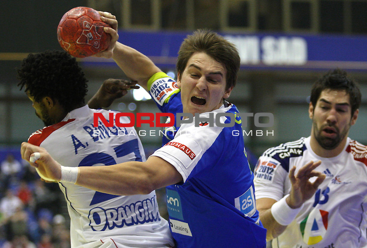 Sebastian Skube of Slovenia shoots the ball during the Men's EHF Euro 2012 Handball Championship match between Slovenia and France on January 22, 2012 at the Spens Hall of Novi Sad. <br /> <br /> Foto &copy;  nph / PIXSELL / Antonio Bronic