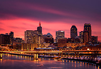 Orange and oink sunset over Saint Paul skyline in late winter.