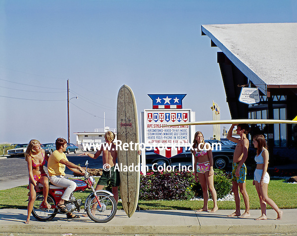 Retro Photograph of Teenagers standing in front of the Admiral Motel with a surf board & moped. Retro Wildwood, NJ