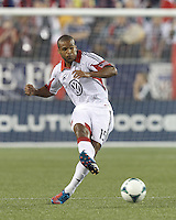 D.C. United defender Ethan White (15) passes the ball.  In a Major League Soccer (MLS) match, the New England Revolution (blue) tied D.C. United (white), 0-0, at Gillette Stadium on June 8, 2013.