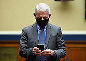 Director of the National Institute for Allergy and Infectious Diseases Dr. Anthony Fauci uses his cell phone before he testifies before the House Committee on Energy and Commerce on the Trump Administration's Response to the COVID-19 Pandemic, on Capitol Hill in Washington, DC on Tuesday, June 23, 2020.   <br /> Credit: Kevin Dietsch / Pool via CNP