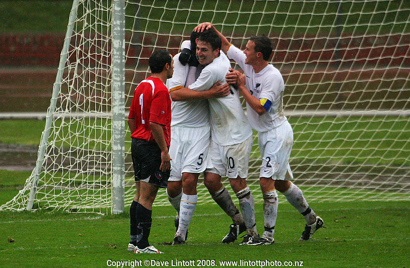 Daniel Ellensohn and Aaron Scott congratulate Michael Boxall for scoring during the international football friendly between the NZ Oly-Whites and Chile Under-23 at Newtown Park, Wellington, New Zealand on Wednesday 3 July 2008. Photo: Dave Lintott / lintottphoto.co.nz
