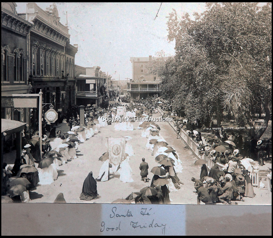BNPS.co.uk (01202 558833)<br /> Pic: FlintsAuctions/BNPS<br /> <br /> Good Friday ceremony in the main square of Santa Fe, New Meico.<br /> <br /> Unseen album reveals the life of a cowboy in the real wild west...<br /> <br /> Fascinating previously unseen early photos of cowboys in the Wild West have come to light 130 years later.<br /> <br /> They show life on the ranches of Colorado and New Mexico in the vast expanses of the south west US in the 1880s.<br /> <br /> One dramatic image captures the thrilling moment a group of cowboys ride towards the camera with hats held aloft.<br /> <br /> The photos are thought to have been taken by a British farmhand who travelled Stateside in the late 19th century to earn a living.