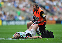 Joe Marler receives treatment for cramp from a physio. Aviva Premiership Double Header match, between London Wasps and Harlequins on September 1, 2012 at Twickenham Stadium in London, England. Photo by: Patrick Khachfe / Onside Images