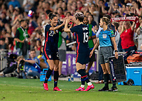 ORLANDO, FL - MARCH 05: Christen Press #23 high fives Megan Rapinoe #15 of the United States during a game between England and USWNT at Exploria Stadium on March 05, 2020 in Orlando, Florida.