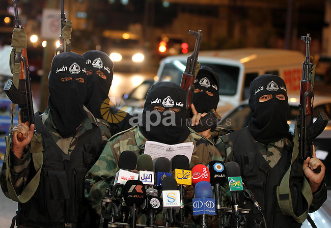 Palestinian Al-Ansar brigade militants take part in a press conference in Gaza city on Oct. 31,2011. Deadly violence between Israel and Gaza militants flared over the weekend. In earlier exchanges of rockets and airstrikes, more than10 militants and an Israeli civilian were killed. Photo by Majdi Fathi