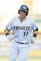 Nicky Delmonico (13) of the Charlotte Knights rounds the bases after hitting a 2-run home run in the bottom of the first inning against the Durham Bulls at BB&T BallPark on May 15, 2017 in Charlotte, North Carolina. The Knights defeated the Bulls 6-4.  (Brian Westerholt/Four Seam Images)