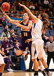 SIOUX FALLS, SD - MARCH 10:  Jackie Rieger #12 from Western Illinois lays the ball up under the arm of Stefanie Mauk #3 from IPFW in the second half of their quarterfinal game Sunday afternoon at the 2013 Summit League Championships in Sioux Falls, SD.  (Photo by Dave Eggen/Inertia)