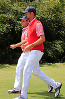 Patrick Reed (USA) and Webb Simpson (USA) on the 15th green during the First Round - Four Ball of the Presidents Cup 2019, Royal Melbourne Golf Club, Melbourne, Victoria, Australia. 12/12/2019.<br /> Picture Thos Caffrey / Golffile.ie<br /> <br /> All photo usage must carry mandatory copyright credit (© Golffile | Thos Caffrey)