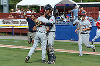 Mahoning Valley Scrappers relief pitcher Kerry Doane (22) and catcher Martin Cervenka (20) embrace as teammates, including James Roberts (48), run to the field after completing a no -hitter against the Batavia Muckdogs on September 1, 2013 at Dwyer Stadium in Batavia, New York.  The Mahoning Valley Scrappers pitching duo of Luis Gomez, Carlos Melo, and Kerry Doane tossed a no-hitter 6-0 victory over Batavia.  (Mike Janes/Four Seam Images)