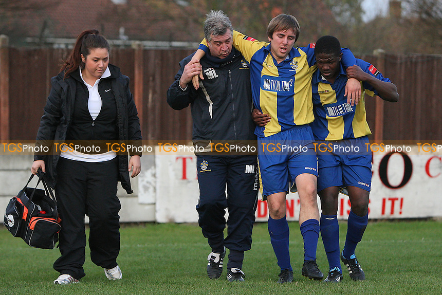 Kurt Smith of Romford (2nd R) leaves the field with an injury - Romford vs Brentwood Town - Ryman League Division One North Football at Mill Field, Aveley FC - 26/11/11 - MANDATORY CREDIT: Gavin Ellis/TGSPHOTO - Self billing applies where appropriate - 0845 094 6026 - contact@tgsphoto.co.uk - NO UNPAID USE.