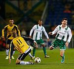 Nederland, Breda, 9 november 2012.Eredivisie.Seizoen 2012-2013.NAC-FC Groningen.Jens Janse (l.) van NAC Breda veroverd de bal van Andraz Kirm (r.)van FC Groningen.