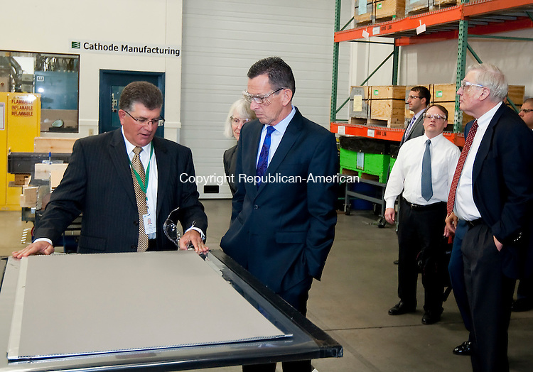 TORRINGTON, CT--- -111915JS06--Anthony F. Rauseo,  <br /> Senior Vice President and Chief Operating Officer for FuelCell Energy, left, discusses the manufacturing process to Gov. Dannel P. Malloy during a tour of their plant as part of a ground-breaking ceremony at FuelCell Energy in Torrington on Thursday. The company will expand their facility by over 100,000 square-feet. <br /> Jim Shannon Republican-American