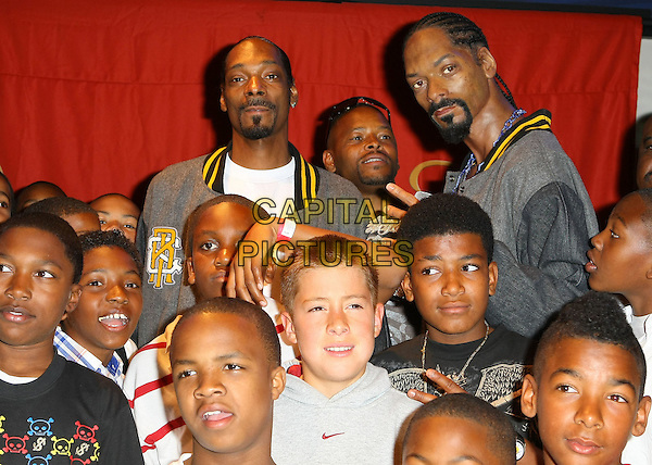 SNOOP DOGG (Cordozar Calvin Broadus, Jr.), WAX FIGURE & POMONA STEELERS.Snoop Dogg unveiling at Madame Tussauds Las Vegas located at the Venetian Resort Hotel and Casino, Las Vegas, Nevada, USA..April 20th, 2009.half length grey gray jacket kids children  goatee facial hair matching outfits .CAP/ADM/MJT.© MJT/AdMedia/Capital Pictures.
