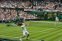 England, London, 23.06.2014. Tennis, Wimbledon, Andy Murray (GBR) foreground vs David Goffin (BEL) in the chair umpire Mohamed Lajani on centercourt<br /> Photo:Tennisimages/Henk Koster