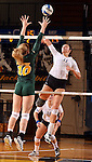 BROOKINGS, SD - OCTOBER 26:  Wagner Larson #11 from South Dakota State tries for a kill past Haley Steffen #10 from North Dakota State in the second game of their match Saturday evening at Frost Arena in Brookings. (Photo by Dave Eggen/Inertia)
