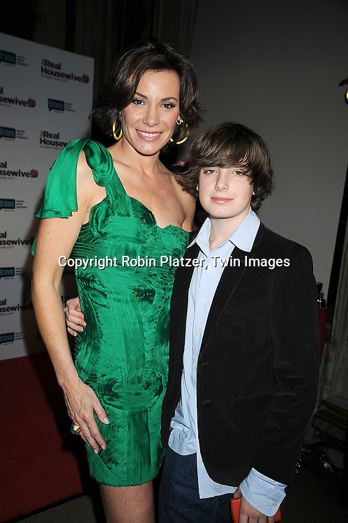 """LuAnn de Lesseps in Ungaro green dress with son Noel..de Lesseps..attending the Premiere for the second season of Bravo's series """"The Real Housewives of New York City"""" on ..February 11, 2009 at Gilt @ The Palace Hotel in New York City. ....Robin Platzer, Twin Images"""