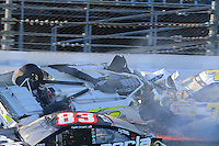Parker Kligerman(30), Paul Menard (27), Ryan Truex (83), Dave Blaney(77) Joey Logano (22) and Trevor Bayne (21) are involved in a crash during practice for the 2014 Daytona 500 at Daytona International Speedway, Daytona Beach, FL, February 19, 2014.  Photographed with a Canon 70D dslr and Canon EF 300mm f2.8 lens. (Photo by Brian Cleary/www.bcpix.com)