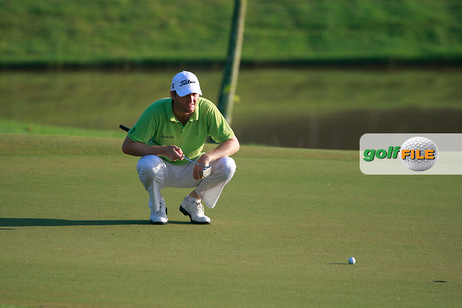 Michael Hoey (NIR) lines up his putt on the 10th green during Thursday's Round 1 of the 2011 Iskandar Johor Open, Horizon Hills Golf Club, Johor, Malaysia, 15th November 2011 (Photo Eoin Clarke/www.golffile.ie)