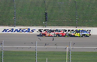 Sept. 28, 2008; Kansas City, KS, USA; Nascar Sprint Cup Series driver Carl Edwards (99) leads Jimmie Johnson (48) during the Camping World RV 400 at Kansas Speedway. Mandatory Credit: Mark J. Rebilas-