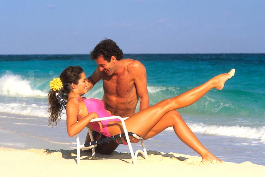 Romantic couple embrace on beach, Caribbean.