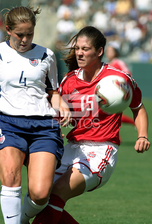 Cat Reddick, left, Kara Lang, right, USA vs. Canada at the Third Place Match of the FIFA Women's World Cup USA 2003. USA 3, Canada, 1. (October 11, 2003). .