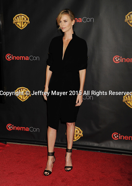 LAS VEGAS, CA - APRIL 21: Actress Charlize Theron arrives at Warner Bros. Pictures Invites You to ?The Big Picture at The Colosseum at Caesars Palace during CinemaCon, the official convention of the National Association of Theatre Owners, on April 21, 2015 in Las Vegas, Nevada.
