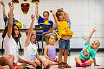 Prospect, CT. 17 July 2019-071719 - From center to left, Ava Wilson, 2, of Cheshire, Emma Odza, 3, of Prospect, and Amelia Williams, 3, of Wolcott and other kids hold their shakers high in the air, during a interactive presentation of playing the drums and other instruments by Bob Bloom hosted by the Friends of the Prospect Library, at the Prospect Fire House in Prospect on Wednesday. Bill Shettle Republican-American