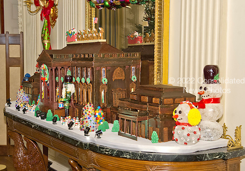 The traditional White House gingerbread house in the State Dining Room on the State Floor as part of the 2015 White House Christmas theme &quot;A Timeless Tradition&quot; at the White House in Washington, DC on Wednesday, December 2, 2015. The gingerbread house weighs almost 500 pounds &ndash; with more than 250 pounds of gingerbread dough, 150 pounds of dark chocolate, 25 pounds of gum paste, 25 pounds of pulled and sculpted sugar work, and 25 pounds of icing. The East and West Wings have been added to the gingerbread house this year for the first time.<br /> Credit: Ron Sachs / CNP