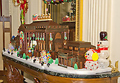 """The traditional White House gingerbread house in the State Dining Room on the State Floor as part of the 2015 White House Christmas theme """"A Timeless Tradition"""" at the White House in Washington, DC on Wednesday, December 2, 2015. The gingerbread house weighs almost 500 pounds – with more than 250 pounds of gingerbread dough, 150 pounds of dark chocolate, 25 pounds of gum paste, 25 pounds of pulled and sculpted sugar work, and 25 pounds of icing. The East and West Wings have been added to the gingerbread house this year for the first time.<br /> Credit: Ron Sachs / CNP"""